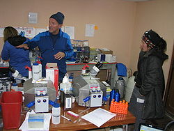 Rob Roach explains the AltitudeOmics 2012 project, with the two Oroboros O2k at 5,200 m in one of the labs at Chacaltaya, Bolivia. Dr.a Isabel Moreno (right) belongs to the physics staff of the Chacaltaya laboratory (Jul/Aug 2012).